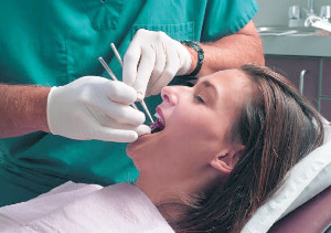 Photo of woman at ==in dental chair for sedation dentistry from Glendale dentist Dr. Robert thein.